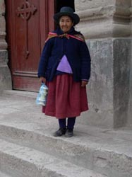 An old lady by the cathedral in Puqio
